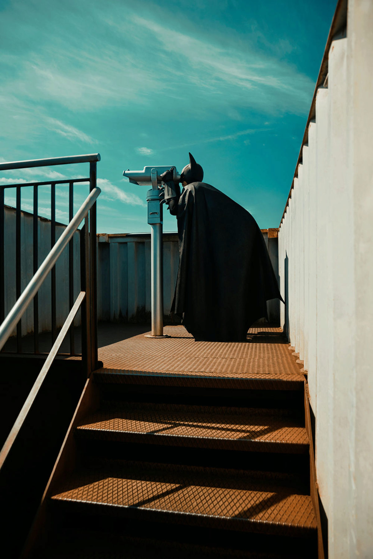 Batman looking through sightseeing binoculars